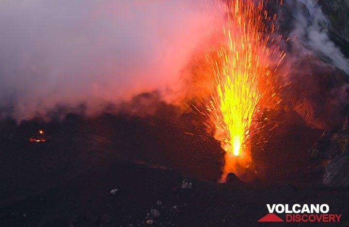 Bright eruption from the NE crater. (c)