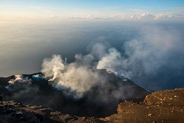 A steam ring is being sent into the air from the hornito-like vent in the NW area of the crater. (Photo: Tom Pfeiffer)
