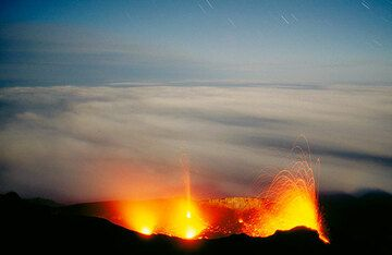 North-west, central and north-east craters in eruption at Stromboli volcano in full-moon. (c)