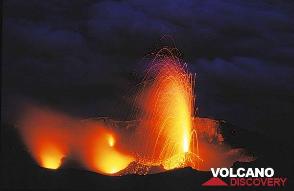 Strong candle-like eruption from the central crater vent of Stromboli.  (c)