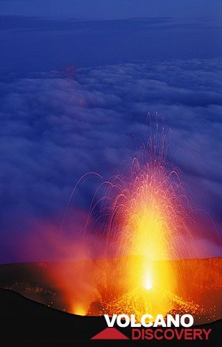 Tall eruption from the central crater of Stromboli. (c)