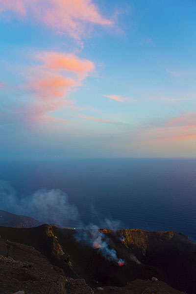 The crater of Stormboli and clouds illuminated by the low sun (Photo: Tom Pfeiffer)
