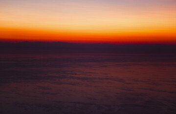 Spectacular sunrise colors above the Tyrrhenian Sea and Calabria (mainland Italy) in the background. (Photo: Tom Pfeiffer)