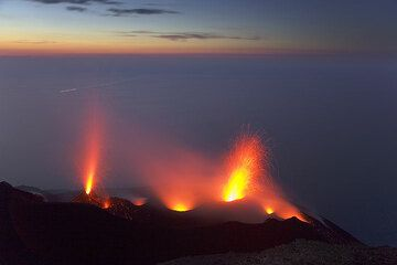 Eruptions of the NE cone of the central crater and the NE crater.  (c)