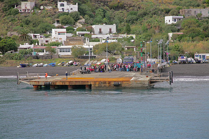 Approaching the pier of Stromboli. Outside the main season, the arrival of the ferry is always an important event in the life on the island. Many people are waiting to leave or greet the arriving. (c)