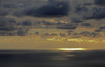 Sunset from Stromboli, in the distance, Filicudi Island is seen. (Photo: Tom Pfeiffer)