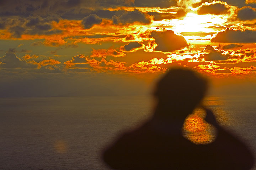 Orange clouds at sunset. (c)