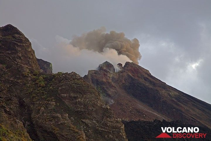 An ash-rich eruption at Stromboli in the evening. (c)