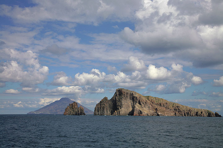 Stromboli is seen in the background behind the small uninhabited islands of Dattilo and Basiluzzo near Panarea. (c)