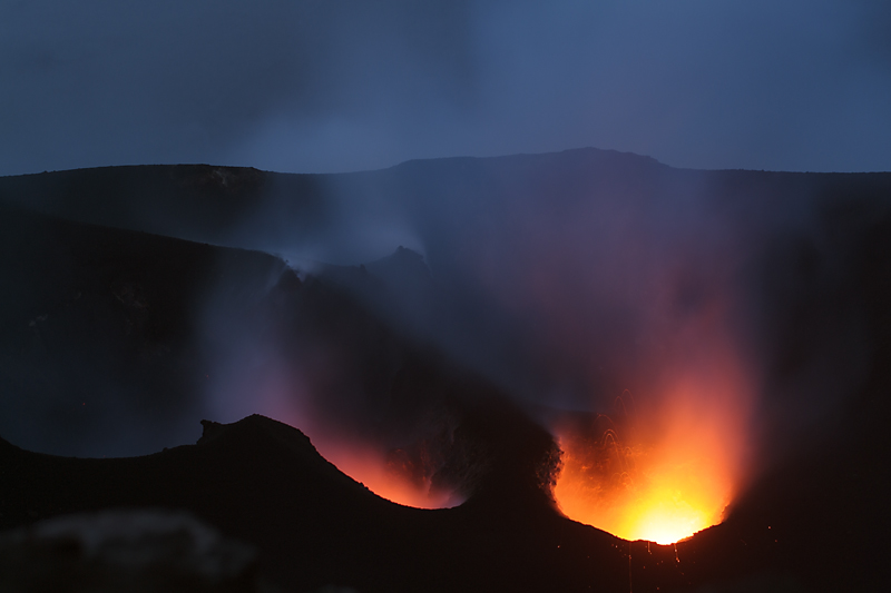 Continuous spattering from the central crater and glow from the SW one (Photo: Marco Fulle)