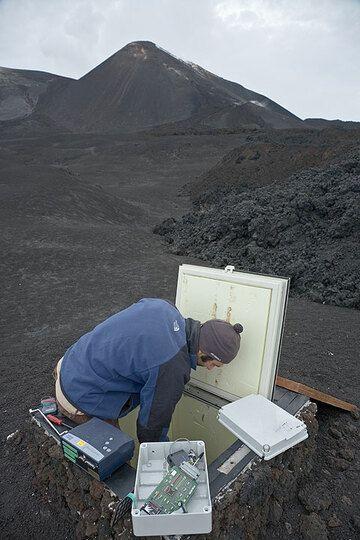 Volcanologist installing a geogravity monitoring station. (Photo: Tom Pfeiffer)