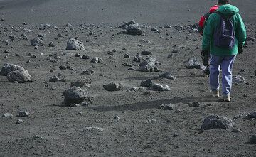 We're passing a lunar landscape of black lapilli and numerous large rounded bombs. (Photo: Tom Pfeiffer)