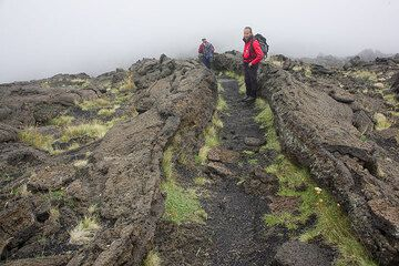 The trail follows the same path as once the lava - we're walking inside a nice small lava channel. (Photo: Tom Pfeiffer)