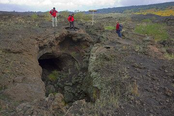 After about two hours from the Grotta del Gelo, we reach another famous lava cave of Etna, the Grotta dei Lamponi.  (Photo: Tom Pfeiffer)