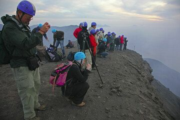 """918 m a.s.l. We and the larger """"blue helmet"""" group have arrived on the summit above the crater terrace, the Pizzo. It's time to prepare tripds and cameras. (Photo: Tom Pfeiffer)"""