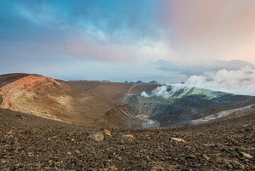 View of the active Fossa crater on a humid summer morning - Lipari (top right) is barely visible. (Photo: Tom Pfeiffer)