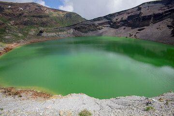 On the rim of Okama crater lake of Zao volcano, NE Honshu, Japan (Photo: Tom Pfeiffer)