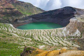 The green Okama crater lake of Zao volcano, NE Honshu, Japan (Photo: Tom Pfeiffer)