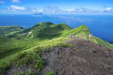 Climbing Suwanose-jima volcano (Tokara Islands, Japan) (Photo: Tom Pfeiffer)
