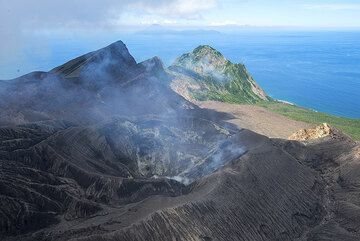View over the crater of Mt Ontake volcano on Suwanose-jima; Nakano-jima island in the background to the NE. (Photo: Tom Pfeiffer)