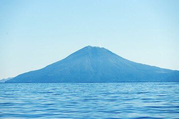 View of Mt Ontake stratovolcano of Nakano-jima volcano, Suwanose-jima's neighbor to the northeast. A gas plume can be seen rising from the summit crater, suggesting the volcano is active. (Photo: Tom Pfeiffer)
