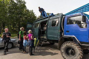3 Sep: the group has all gathered and we decide to leave already today to Karymsky as a small Pacific cyclon with very bad weather is announced to hit over the next day, probably making flights impossible then. We load our luggage onto Sasha's 4x4 truck. (Photo: Tom Pfeiffer)