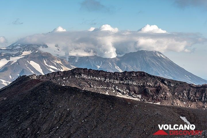 View over Gorely's SE summit crater towards the SE, where the summit of neighboring Mutnovsky volcano is seen. (Photo: Tom Pfeiffer)