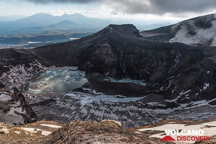 The crater lake of the central summit crater of Gorely is partially frozen. (Photo: Tom Pfeiffer)