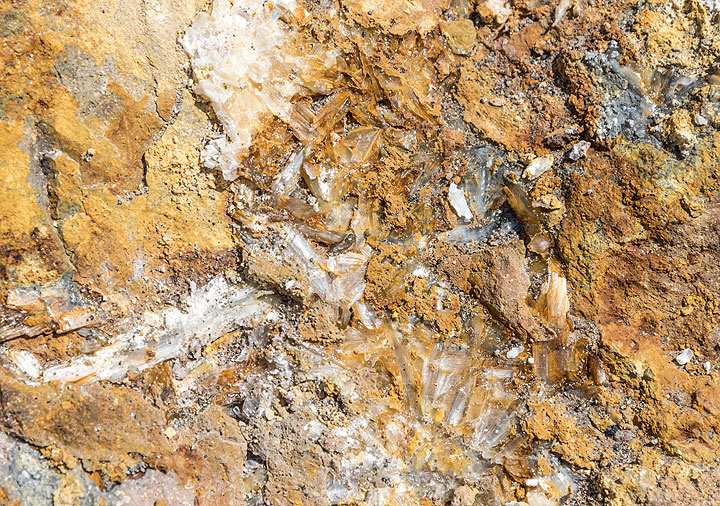 Gypsum crystals and sulfur deposits that have formed by the fumarolic activity abound everywhere. (Photo: Tom Pfeiffer)