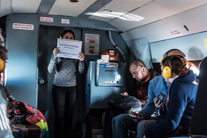 An announcement by the flight attendant: we are about to reach and overfly Karymsky volcano. (Photo: Tom Pfeiffer)