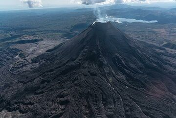 The young stratocone of Karymsky is composed mainly by viscous lava flows occupying a circular caldera. (Photo: Tom Pfeiffer)