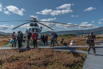First stop as the helicopter has landed near the rangers' station. (Photo: Tom Pfeiffer)