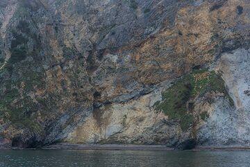 Dramatic coastlines of eroded volcanic rocks. (Photo: Tom Pfeiffer)