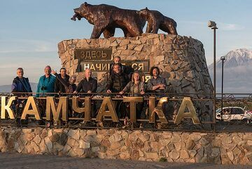 """... the volcanoes! group photo at the """"Russia begins here"""" monument. (Photo: Tom Pfeiffer)"""