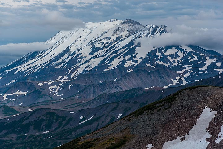 Zupanovsky volcano is one of the Eastern Range's principal volcanoes; it has an elongated summit with 3 main vents. (Photo: Tom Pfeiffer)