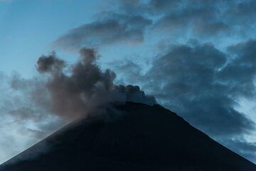 Ash emissions from Karymsky volcano in the beginning of the blue hour. (Photo: Tom Pfeiffer)