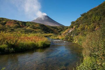 Small river and Karymsky volcano in background. (Photo: Tom Pfeiffer)