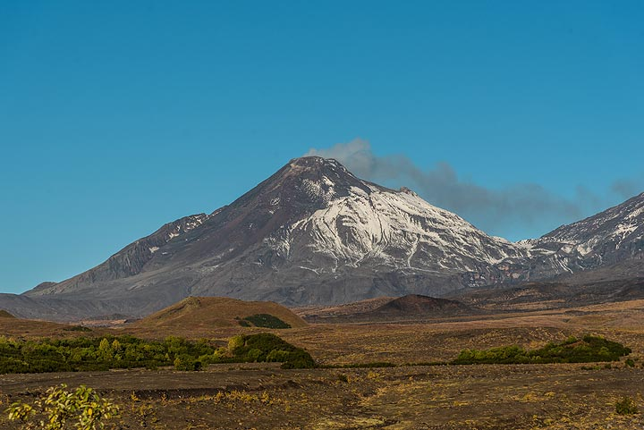 Active Bezymianny volcano with its summit caldera and steaming lava dome. (Photo: Tom Pfeiffer)