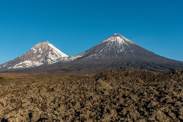 Kamen and Klyuchevskoy volcanoes in the morning. (Photo: Tom Pfeiffer)