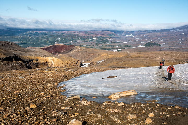 The beginning of the trail to Mutnovsky's crater passes small snow fields left from last winter. (Photo: Tom Pfeiffer)