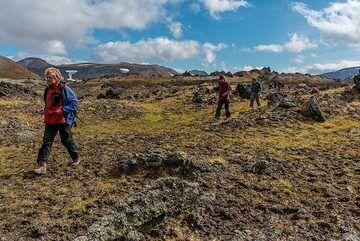 Walking over a prehistoric massive lava flow toward an old lava cave. (Photo: Tom Pfeiffer)