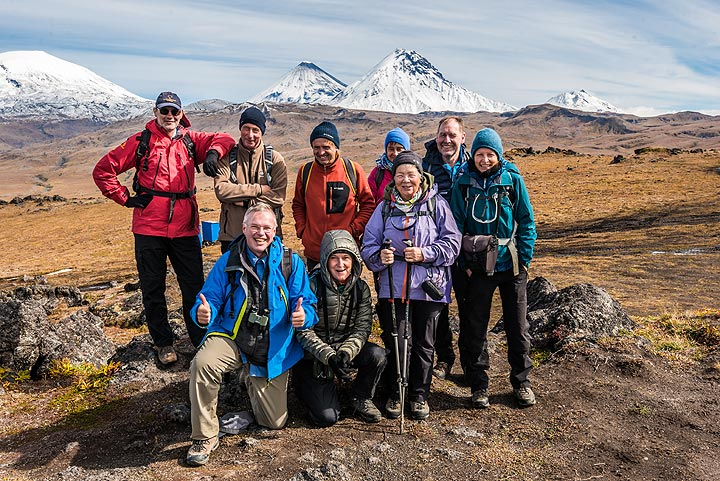 Group photo with no less than 4 (potentially) active volcanoes in the background! (Photo: Tom Pfeiffer)