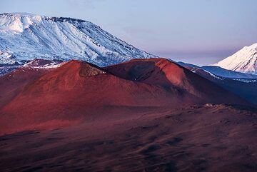 Another cinder cone higher up on the rift is painted red by the last sunlight. (Photo: Tom Pfeiffer)