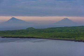 Silhouettes of Chikurachki and Fuss volcanoes on Paramushir Island in the background. (Photo: Tom Pfeiffer)