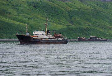 Fishing ship in the bay (Photo: Tom Pfeiffer)