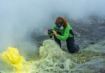 Marina taking pictures close-up, protected by the fumes with a gas mask... (Photo: Tom Pfeiffer)