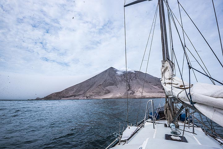 We are approaching the island volcano Raikoke which has erupted with a devastating large explosion on 22 June 2019, which left a lush green island now completely covered in ash. (Photo: Tom Pfeiffer)