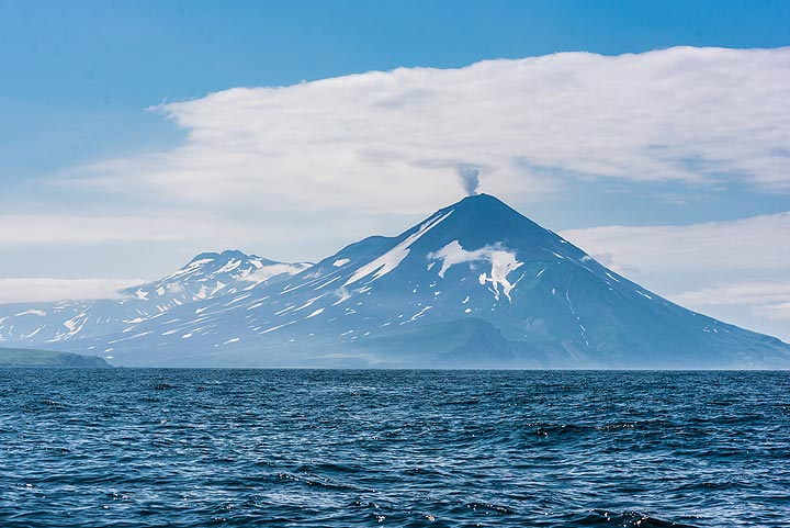 Chikurachki volcano, one of the most active in the Kuriles, is emitting a plume of steam and possibly some ash. (Photo: Tom Pfeiffer)