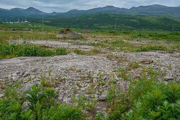 In the morning of 4 Nov 1952, a magnitude 9 earthquake occurred off the coat of Kamchatka, sending a powerful tsunami that destroyed the previous town of Severo Kurilsk once located in this flat area. (Photo: Tom Pfeiffer)