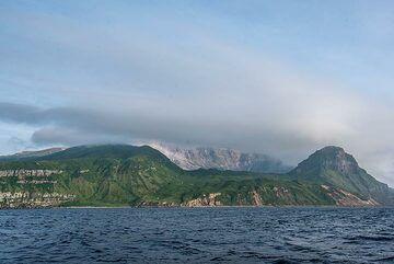 Shiashkotan Island with the caldera of Kuntomintar volcano; fumaroles are visible inside the collapse scar. (Photo: Tom Pfeiffer)
